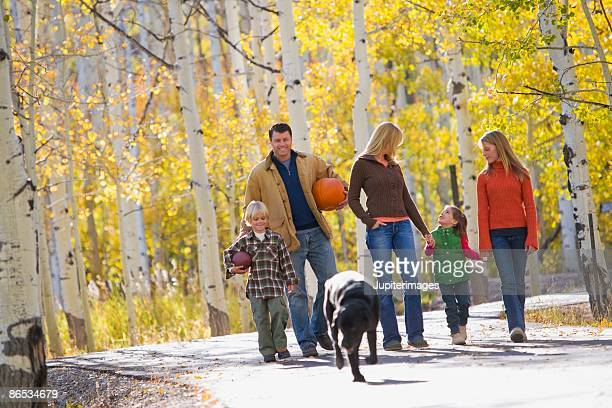 family walking in woods - labrador preto imagens e fotografias de stock