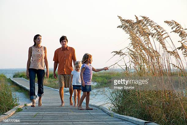 family walking on beach walkway - hilton head stock pictures, royalty-free photos & images