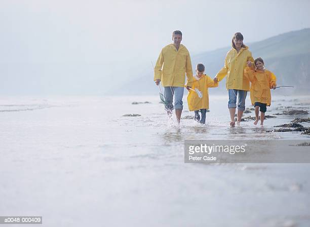 Family Walking on BeachPaddlingCopy spaceFunVacationsTogetherness