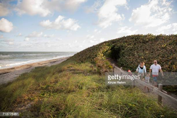 Family walking on coastal path, Blowing Rocks Preserve, Jupiter, Florida, USA