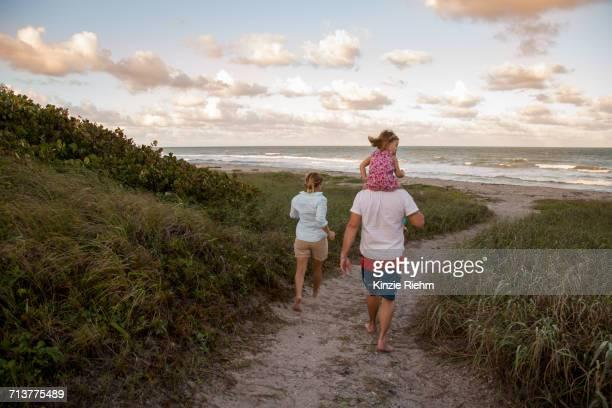 family walking on coastal path, blowing rocks preserve, jupiter, florida, usa - jupiter island stock photos and pictures