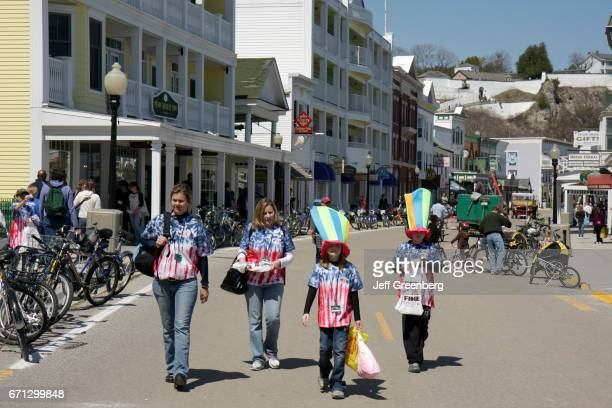 A family walking on Main Street at Mackinac Historic State Parks Park