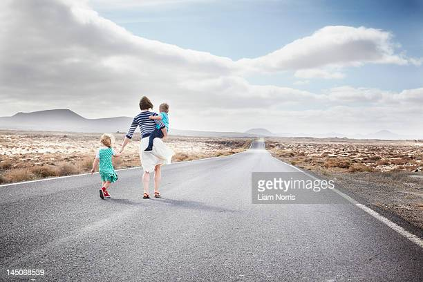 Family walking on paved rural road