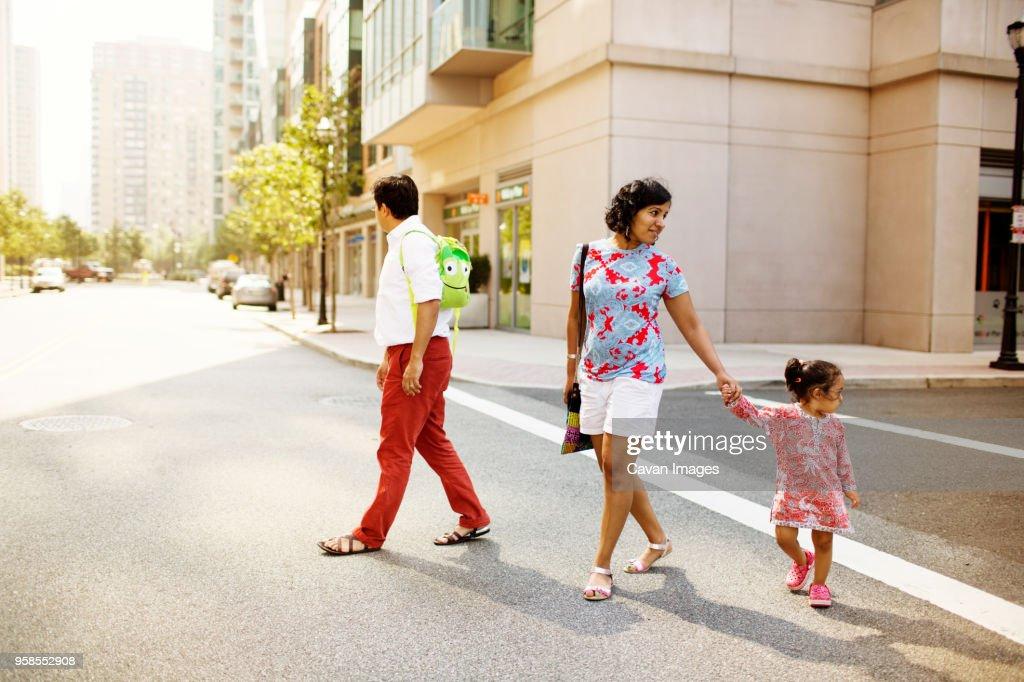 Family walking on street : Stock Photo