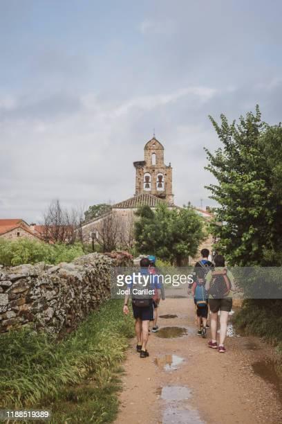 family walking the camino de santiago in spain - camino de santiago stock pictures, royalty-free photos & images