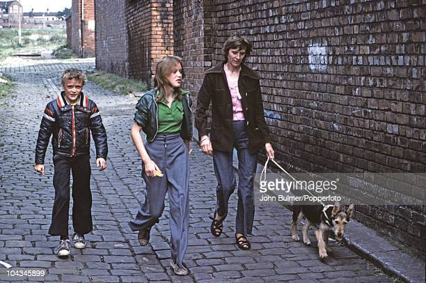 A family walking the dog on a street in Manchester England in 1976