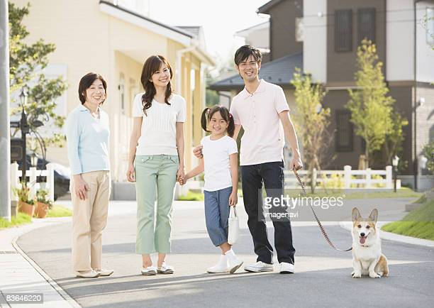 family walking their dog  - guide dog photos et images de collection
