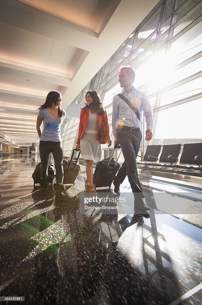 family walking through airport : Stock Photo