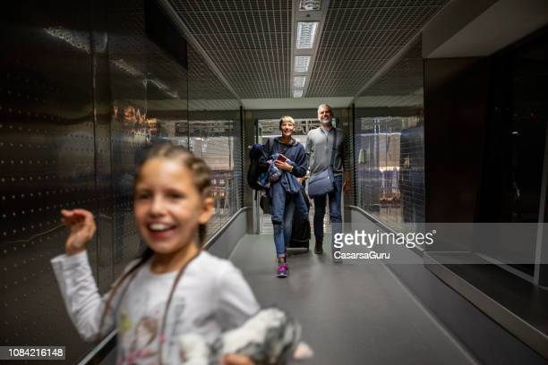 Family Walking Thru Corridor on Airport Departure Area