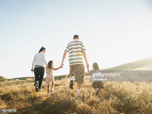 Family walking together in rural field