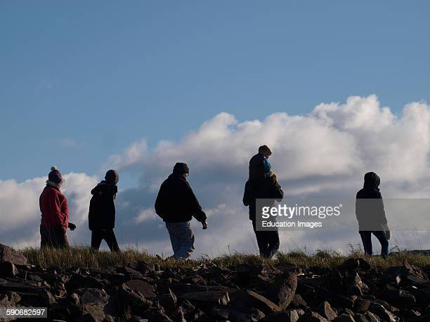 Family Walking Together In Winter Instow Devon UK