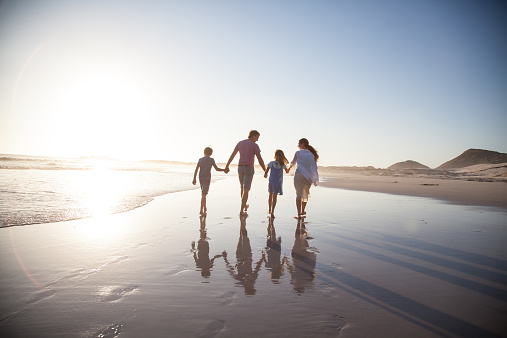 Family walking together on a beach - gettyimageskorea