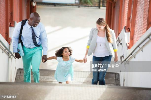 Family walking up stairs