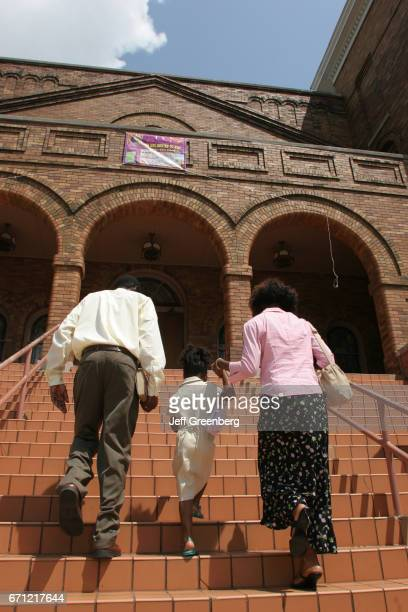 A family walking up the steps to the entrance of the 16th Street Baptist Church