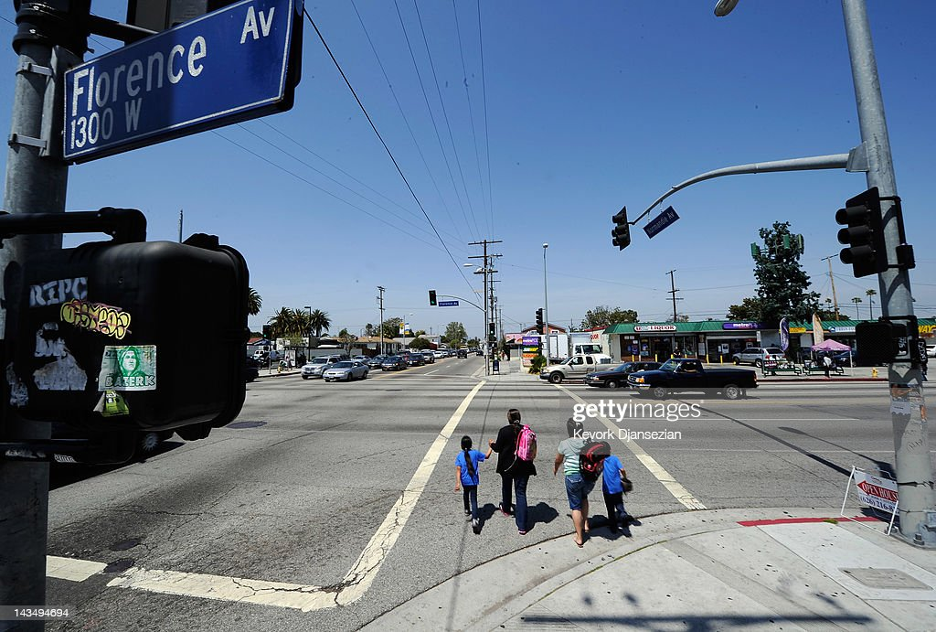 A family walks across the intersection of Florence and Normandy Avenues in South Los Angeles on April 27, 2012 in Los Angeles, California. The intersection was the scene of the beating of truck driver Reginald Denny on April 29, 1992 during the early stages of the Los Angeles riots. It's been 20 years since the Rodney King verdict that sparked the riots.