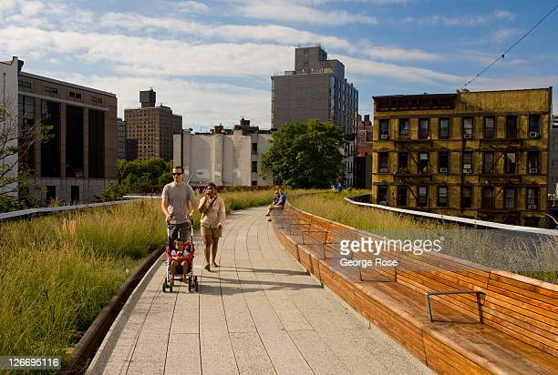 A family walks along the High Line near 30th Street on September 10 2011 in New York City The High Line is a onemile long New York City Park on the...