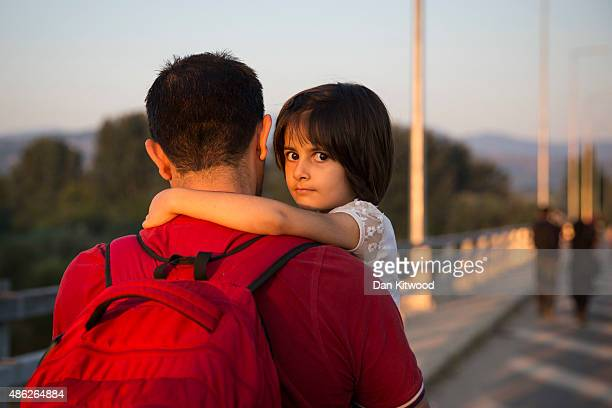 A family walks the final few kilometers through fields towards the Macedonian border to have their papers processed before crossing on September 3...