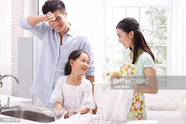 family washing dishes in kitchen - kids with cleaning rubber gloves stock pictures, royalty-free photos & images