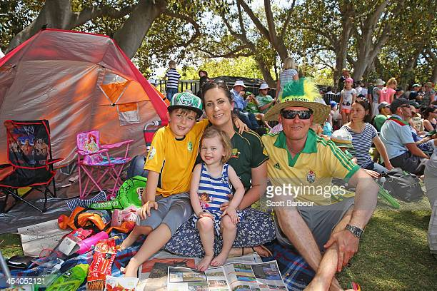 A family watch the cricket on the hill during day three of the Second Ashes Test match between Australia and England at Adelaide Oval on December 7...