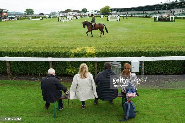 Family watch the Hunter Class of horses in the main ring on the first day of the 162nd Great Yorkshire Show at the Harrogate Show Ground on July 13,...