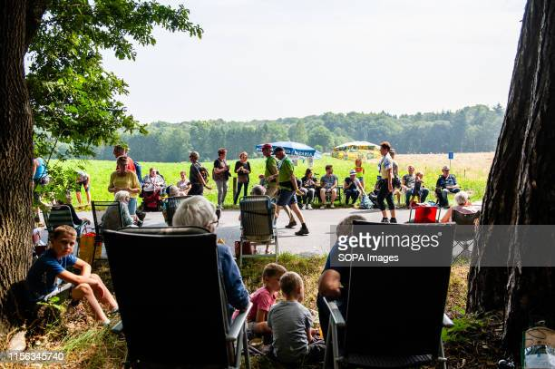 Family watches participants walking, during the third day. Since it is the worlds biggest multi-day walking event, the Four Days March is seen as the...