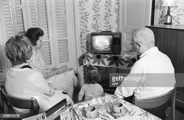 A family watches the American astronaut Neil Armstrong commander of Apollo 11 setting his foot on the moon 21 July 1969 in Paris Hundreds of millions...
