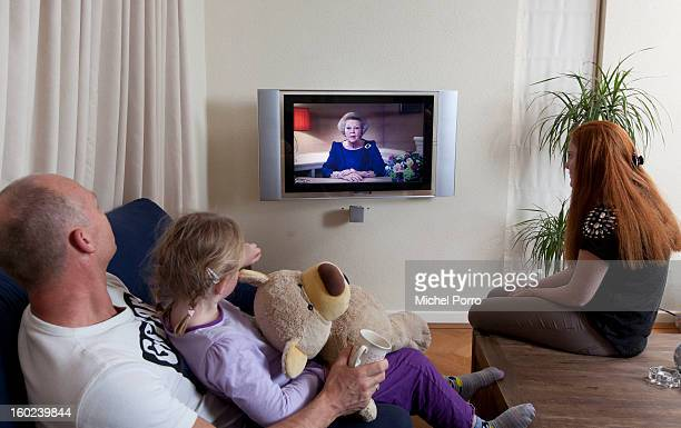 A family watches the television as Queen Beatrix of The Netherlands announces her abdication in favour of her son Prince WillemAlexander on January...