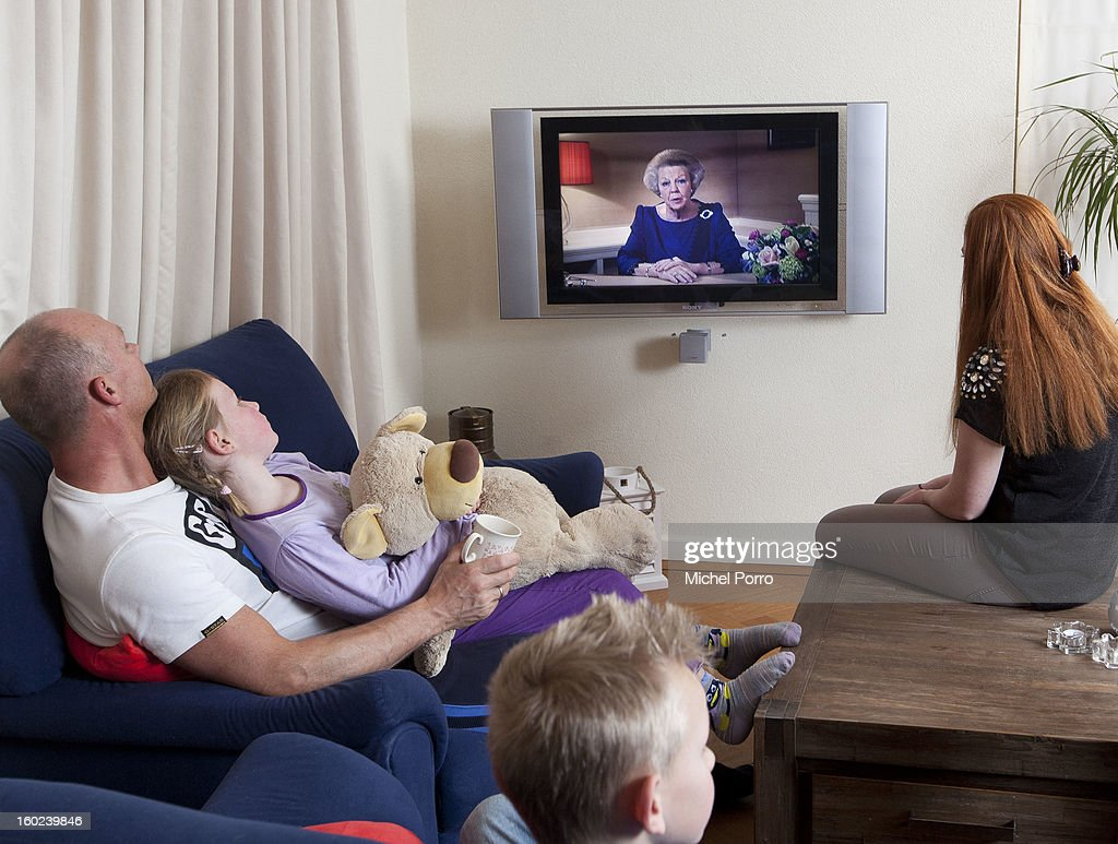 A family watches the television as Queen Beatrix of The Netherlands announces her abdication in favour of her son Prince Willem-Alexander on January 28, 2013 in Wassenaar, Netherlands.