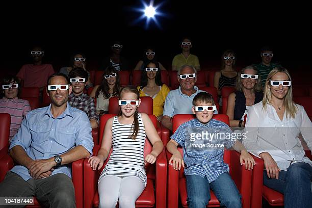 family watching 3d movie at the movie theater - 3d mom son stock photos and pictures