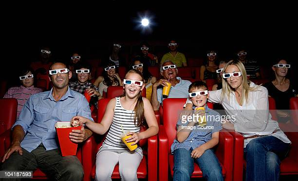 family watching 3d movie at the movie theater - arts culture and entertainment stock pictures, royalty-free photos & images