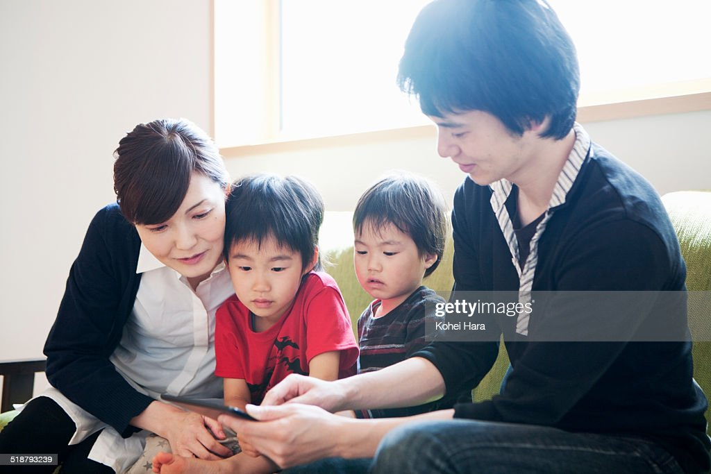 family watching a digital tablet : Stock Photo