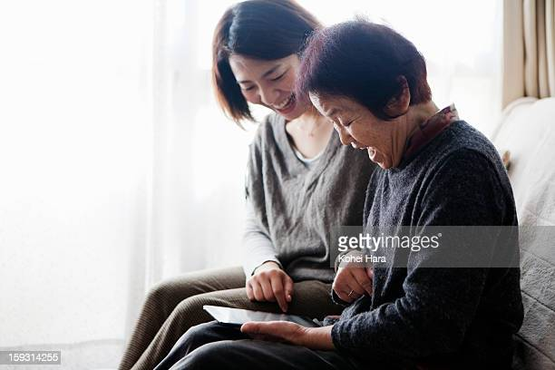 family watching a digital tablet together