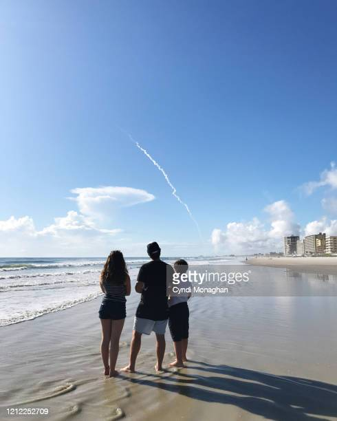 family watching a rocket launch at cape canaveral from daytona beach shores - kick off stock pictures, royalty-free photos & images
