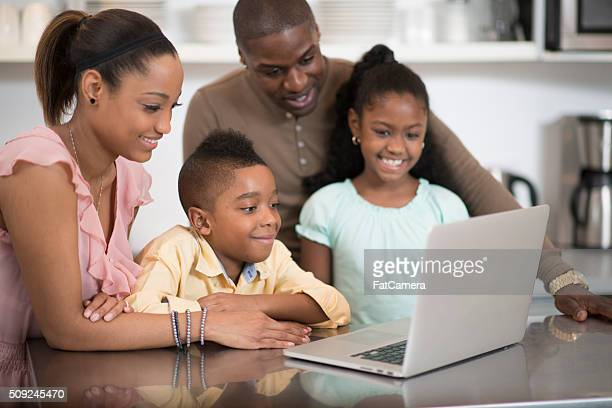 Family Watching a Video on a Laptop