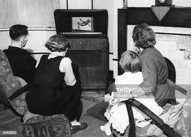 A family watching athletics on television