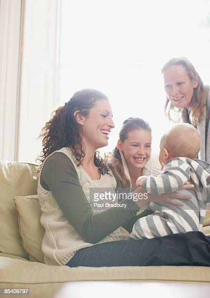 family watching baby - british granny stock photos and pictures