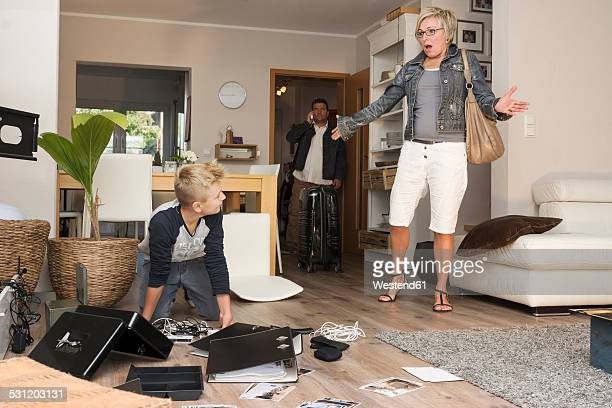Family watching chaos after burglary when coming back in their one-family house