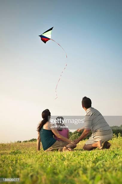 Family watching kite in sky