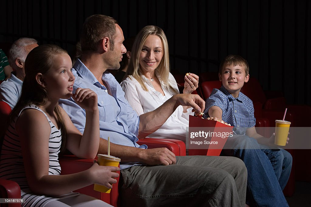 Family watching movie at the movie theater : Stock Photo