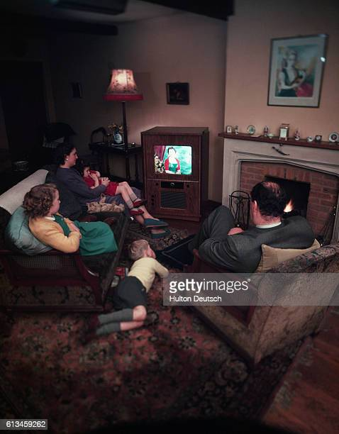 Family watching one of the first color televisions.