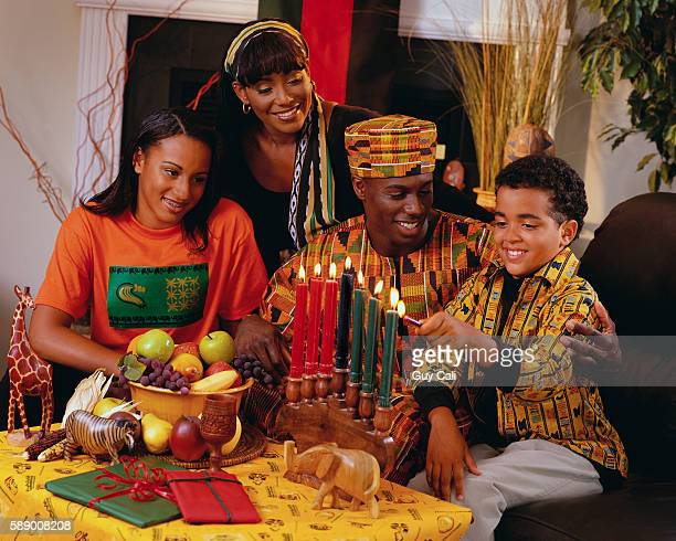 family watching son light candles - kwanzaa stock pictures, royalty-free photos & images
