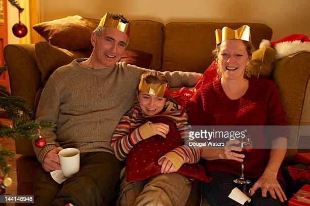 Family watching television at christmas