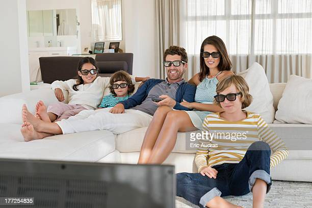 family watching television at home while wearing 3d glasses - 3d mom son stock photos and pictures