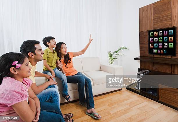 family watching television in a living room - 3d mom son stock photos and pictures