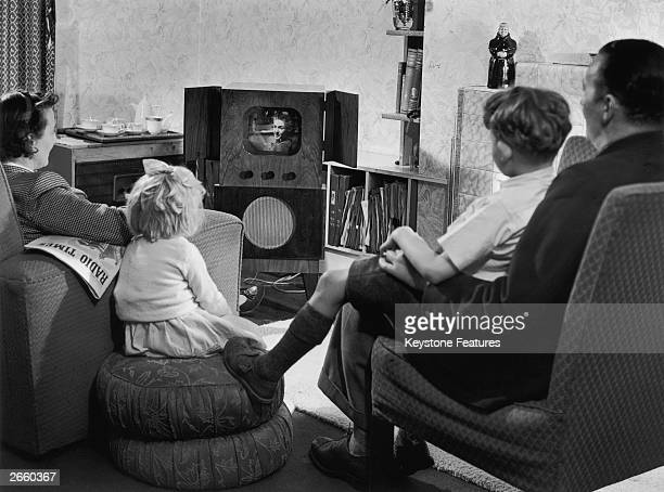 A family watching television in their home