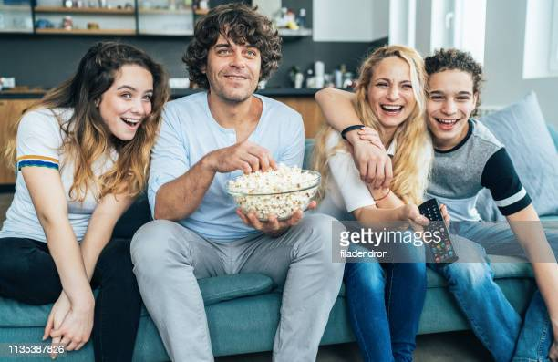 family watching television - remote controlled stock photos and pictures