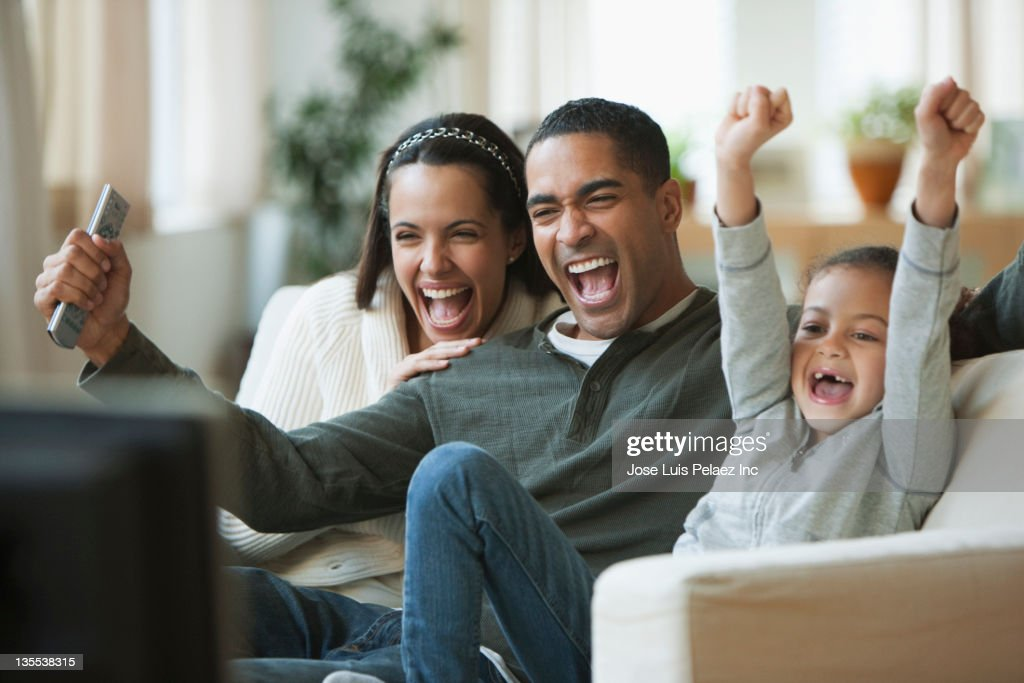 Family watching television together : Stock Photo