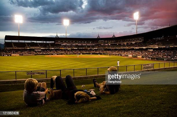 family watching the ball game - baseball sport stock pictures, royalty-free photos & images