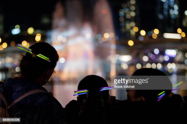 A family watching the Magicians of Light show during Vivid on May 26 2017 in Sydney Australia Vivid Sydney is an annual festival that features light...