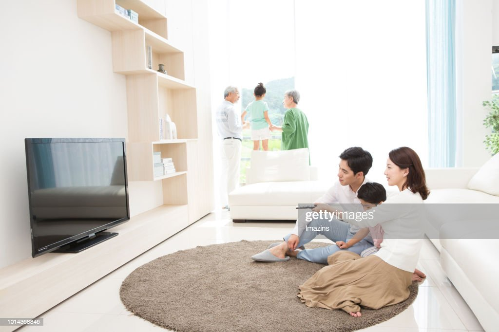 Family Watching Tv In Living Room High-Res Stock Photo ...